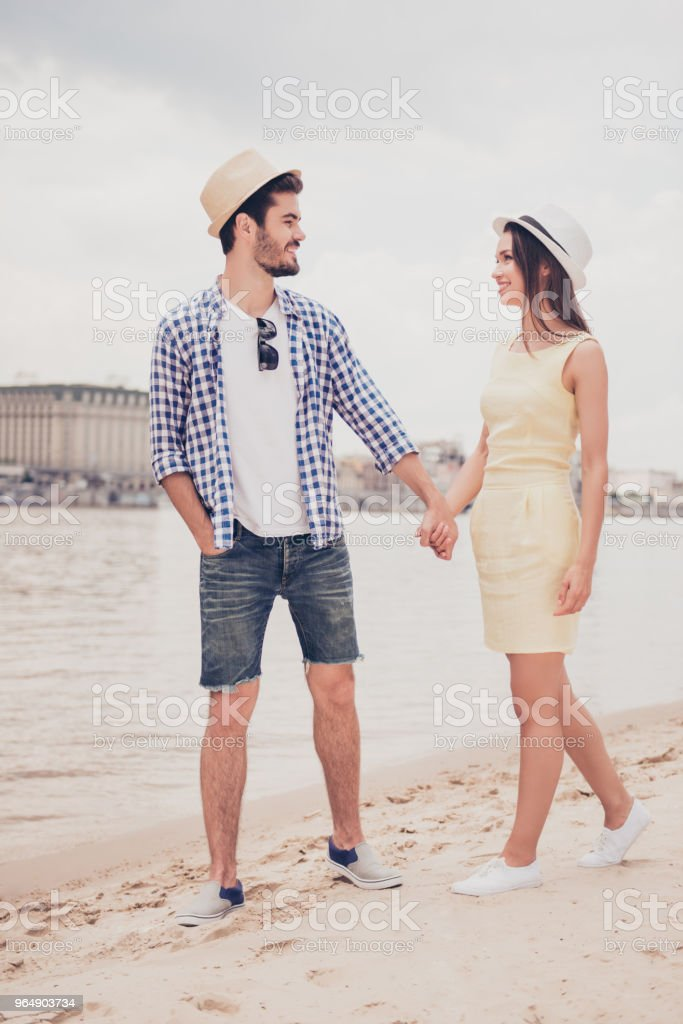 Full size of romantic lovely sweet couple holding hands having meeting outdoor walking near quay sea looking at each other enjoying time together having vacation trip journey wearing dress shirt jeans royalty-free stock photo