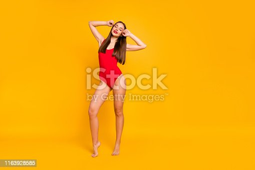 Full size photo of beautiful stunning lady bright red lipstick nice eyes closed weekend, seaside ocean wear red swim suit isolated yellow background