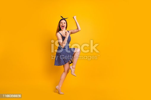 Full size photo of cute,youth shout yeah have aims close eyes raise fists isolated over yellow background