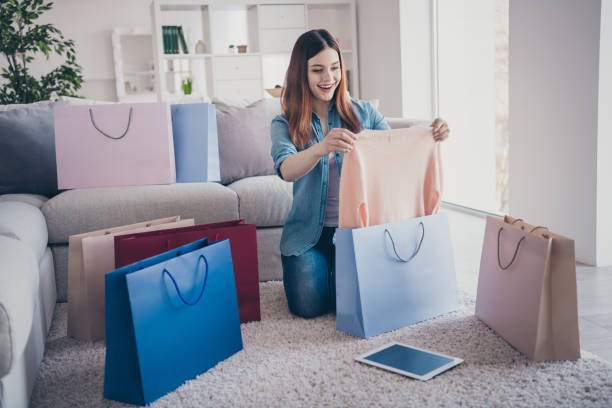 full size photo of excited cheerful red hair girl sit on comfort floor carpet with many different bags hold her new purchase impressed scream wow omg present gift after summer holidays indoors - online shopping imagens e fotografias de stock