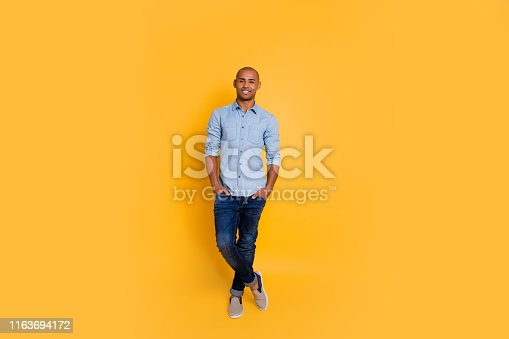 1163696387 istock photo Full size photo of pretty person youth hands palms pocket feel content isolated over yellow background 1163694172