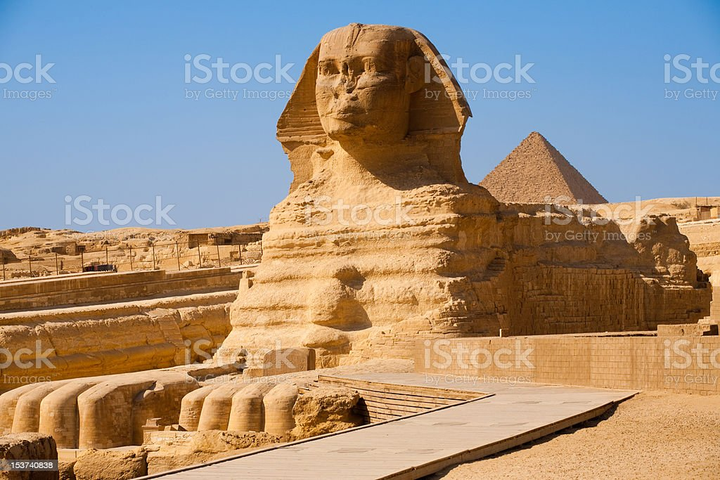 Full Sphinx Profile Pyramid Giza Egypt stock photo