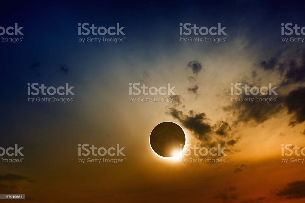 A full sun eclipse with clouds stock photo