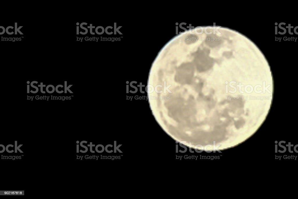Full super moon over dark black sky at night stock photo