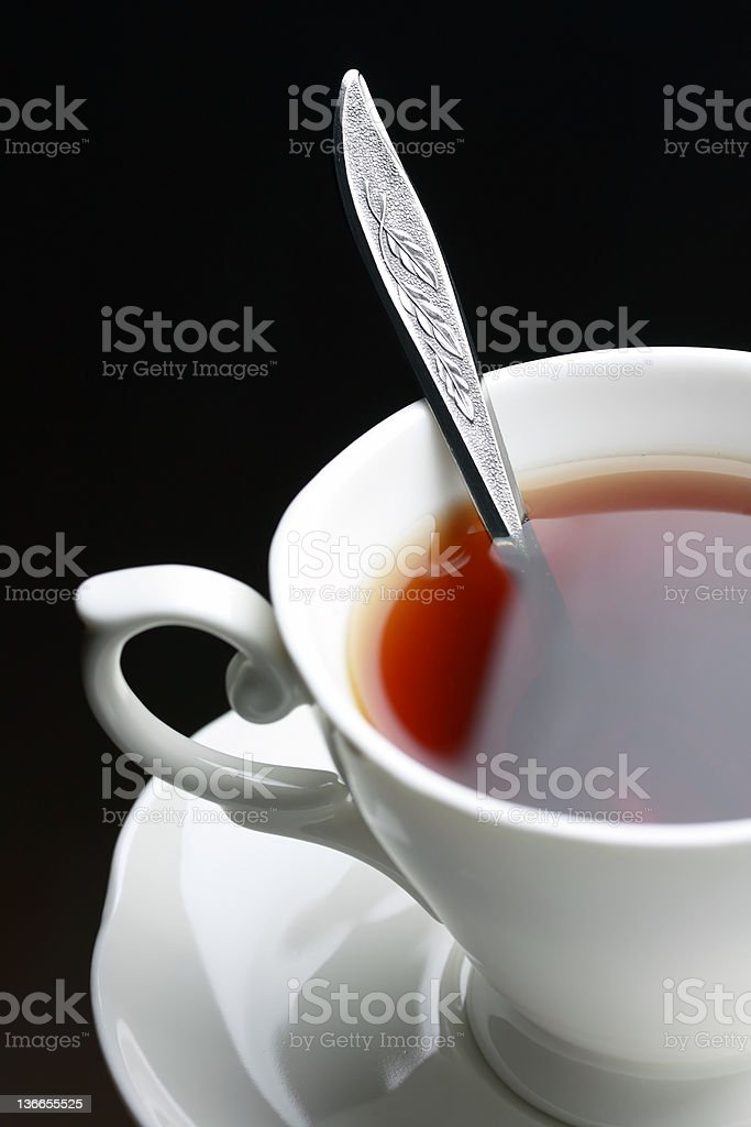 full tes cup with spoon stock photo