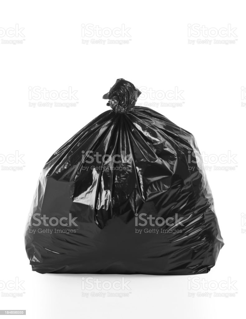 Full, tied trash bag on white background stock photo
