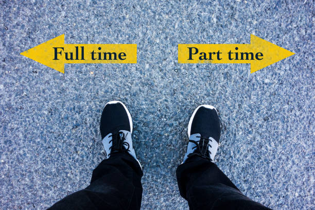 full time vs part time direction sign text on asphalt ground stock photo