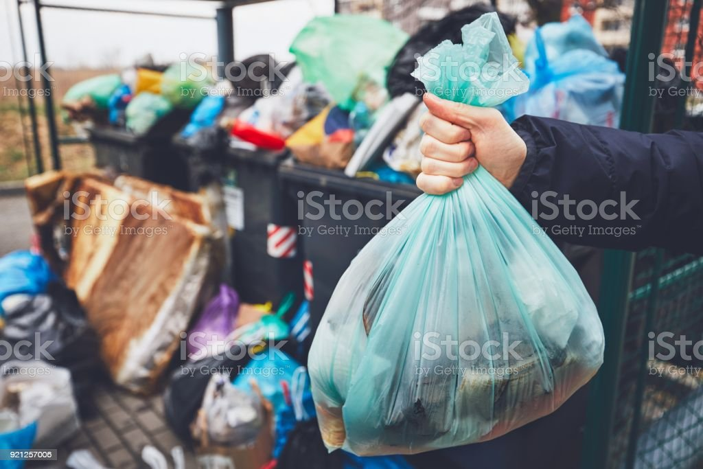 Full trash cans with rubbish bags stock photo