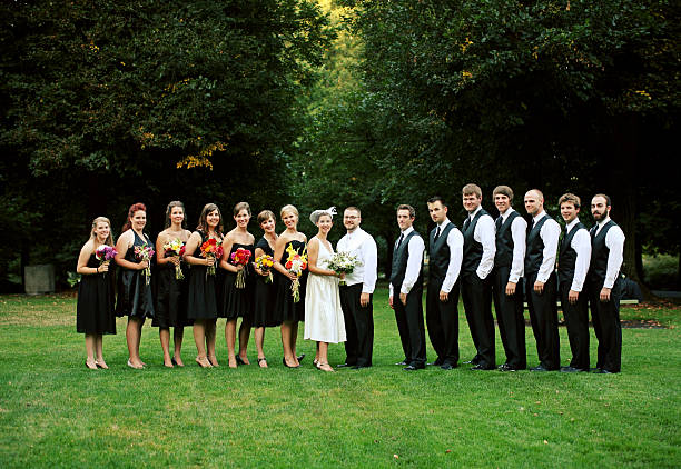 Full Wedding Party in Line at a Park stock photo
