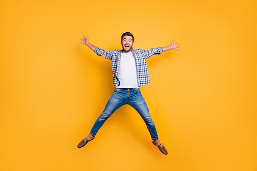 istock Full-legh portrait of of crazy and excited handsome man jumping 1036113160