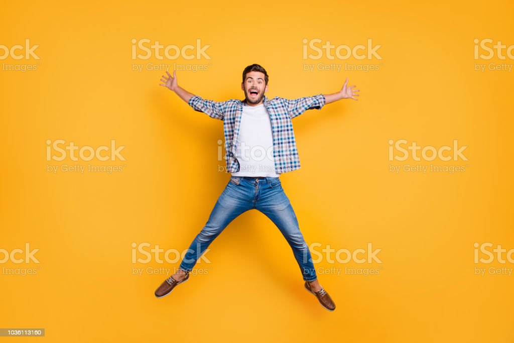 Full-legh portrait of of crazy and excited handsome man jumping stock photo