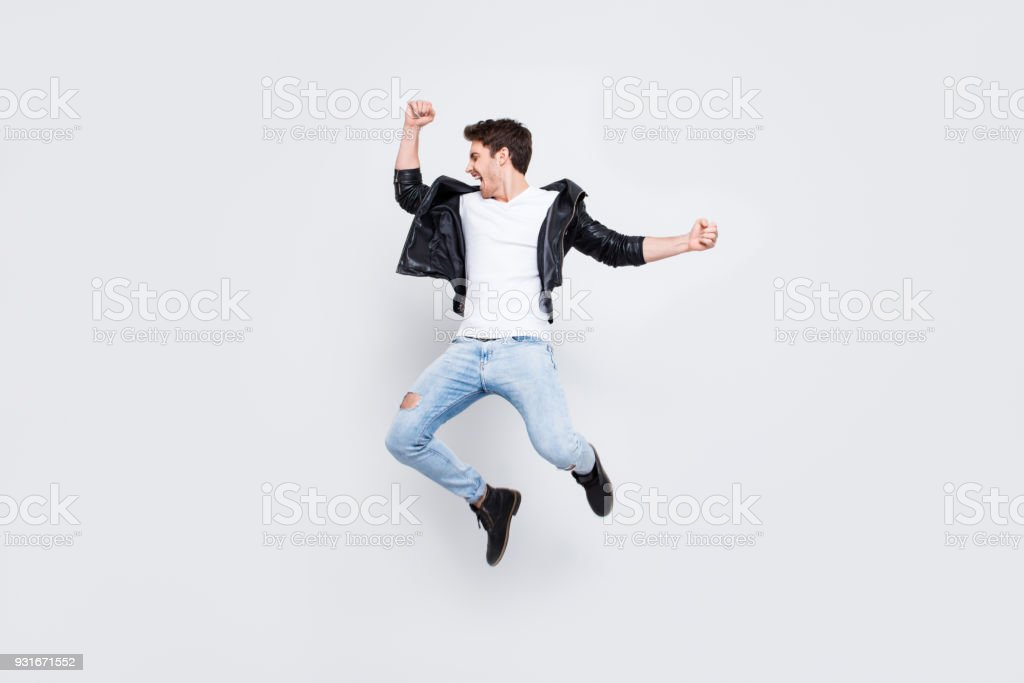 Full-length full-size photo People leisure lifestyle craziness concept. Charismatic energetic handsome enthusiastic lucky confident guy wearing  trendy urban style clothes isolated on white background stock photo
