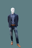 Full-length male mannequin dressed fashionable clothes, isolated. No brand names or copyright objects.