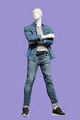 Full-length male mannequin dressed in casual clothes, isolated.  No brand names or copyright objects.
