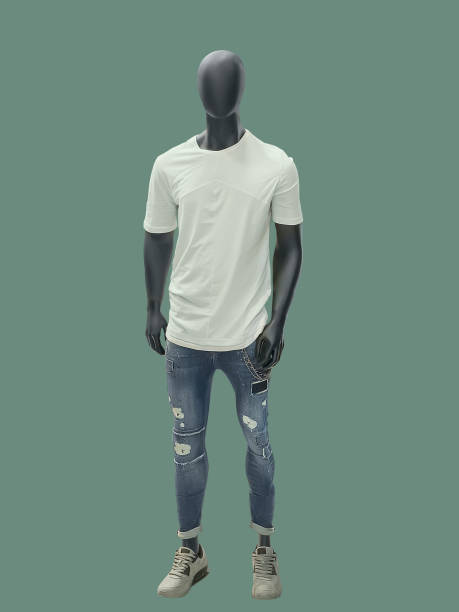 Full-length man mannequin. Full-length man mannequin dressed in summer casual clothes, isolated on green background. No brand names or copyright objects. retail equipment stock pictures, royalty-free photos & images