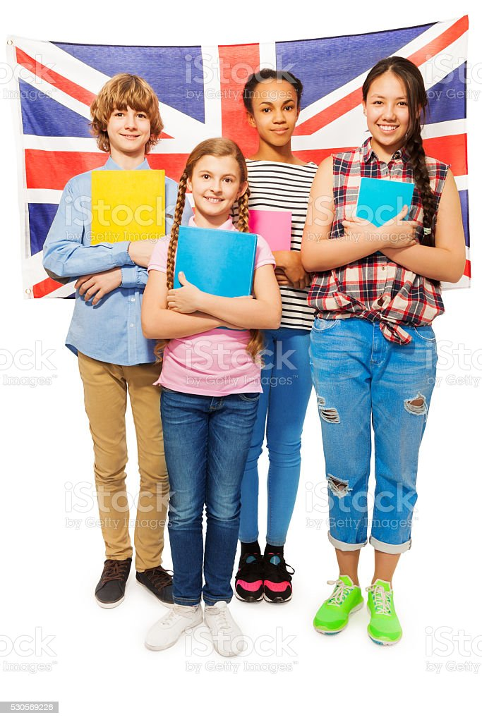 Full-length picture of kids against British flag stock photo