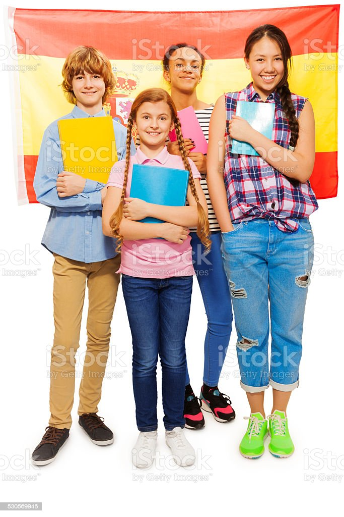 Full-length picture of kids with Spanish flag stock photo