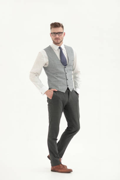 full-length portrait of a serious young man stock photo