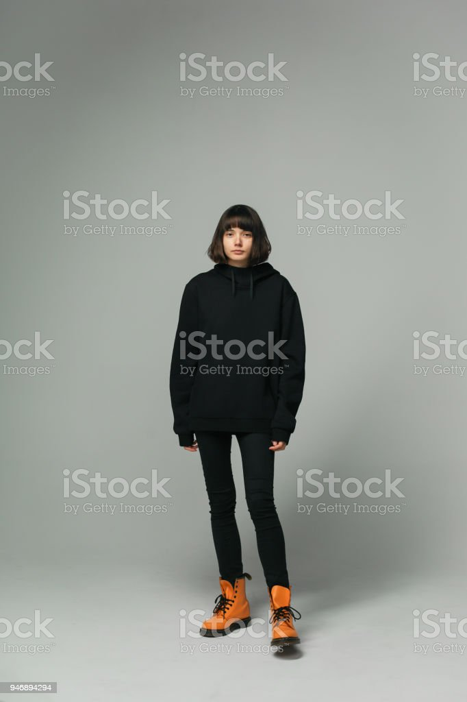 full-length portrait of stylish woman in casual black outfit stock photo