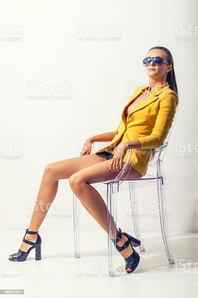 Full-length portrait young elegant woman in the yellow jacket stock photo
