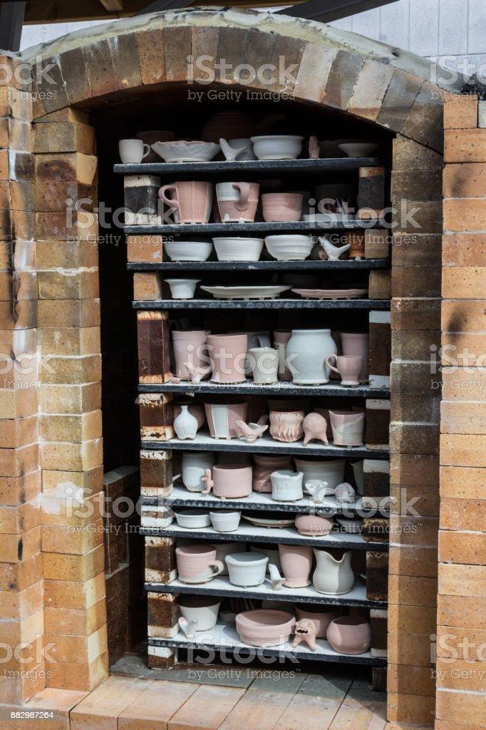 Fully packed fire brick soda kiln oblique view, handmade hobby stock photo