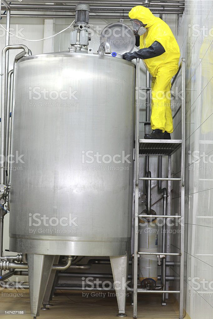 Fully protected engineer industrial process in factory royalty-free stock photo