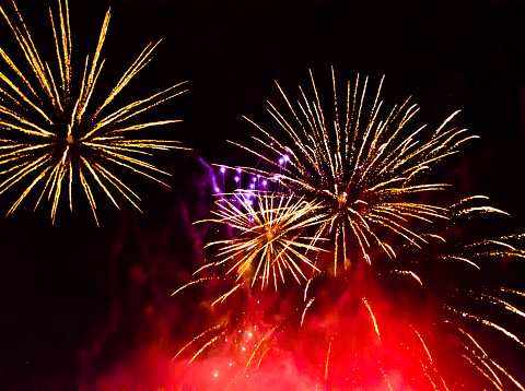 fulminate, colorful, luminous, real  firework at night at afestivity in a city in Germany