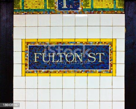 Landmark New York City subway at Fulton Street fish market sign