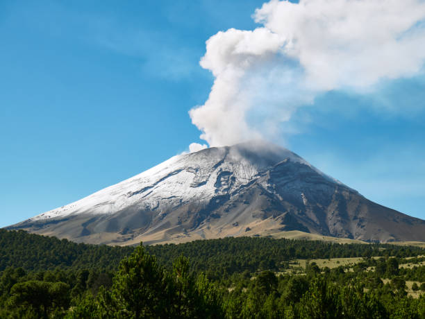 Fumarole comes out from Popocatepetl volcano Fumarole comes out from the crater Popocatepetl volcano seen from Itza-Popo National Park, Mexico puebla state stock pictures, royalty-free photos & images