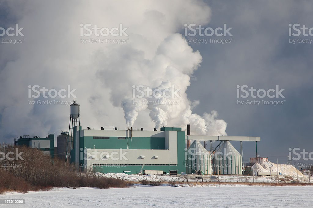 Fumes over a Large Industrial Building stock photo