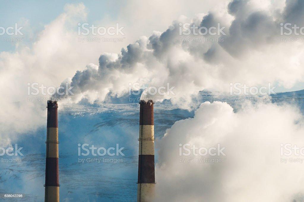 Fuming factory chimney. foto