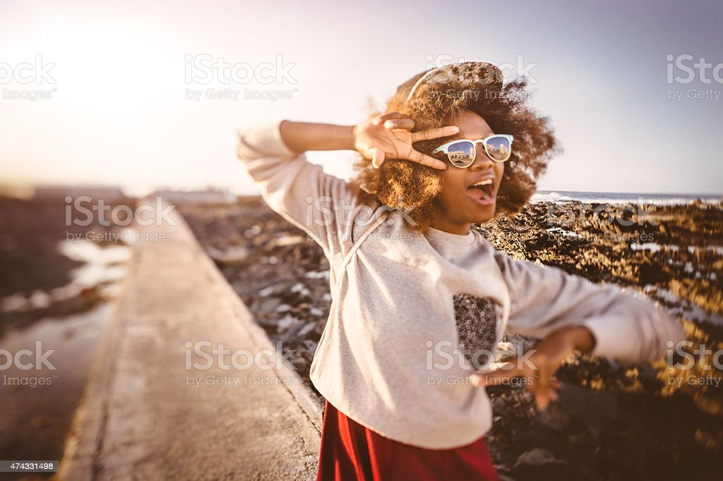 Fun African American girl hipster showing peace signs stock photo