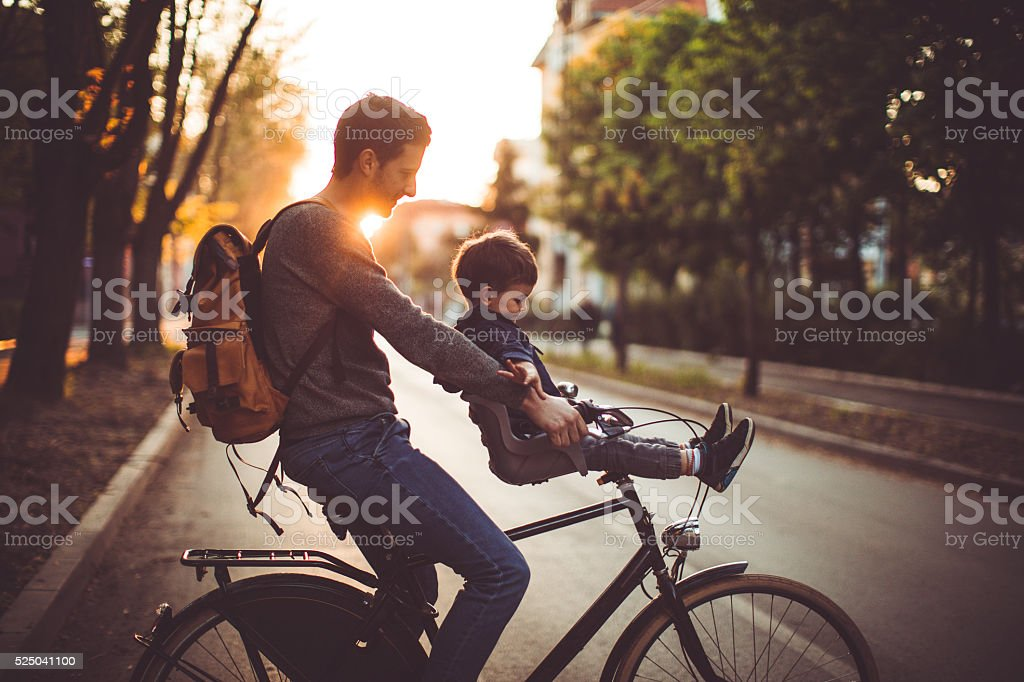 Fun and games on a bicycle stock photo