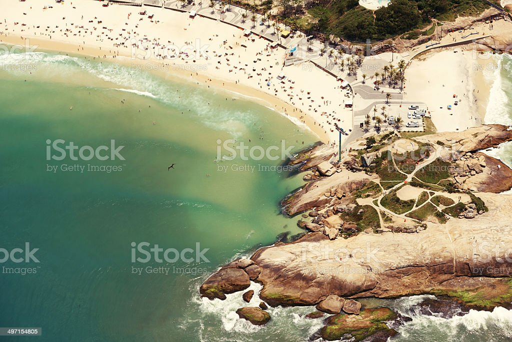 Fun and sun by the rocky shore royalty-free stock photo
