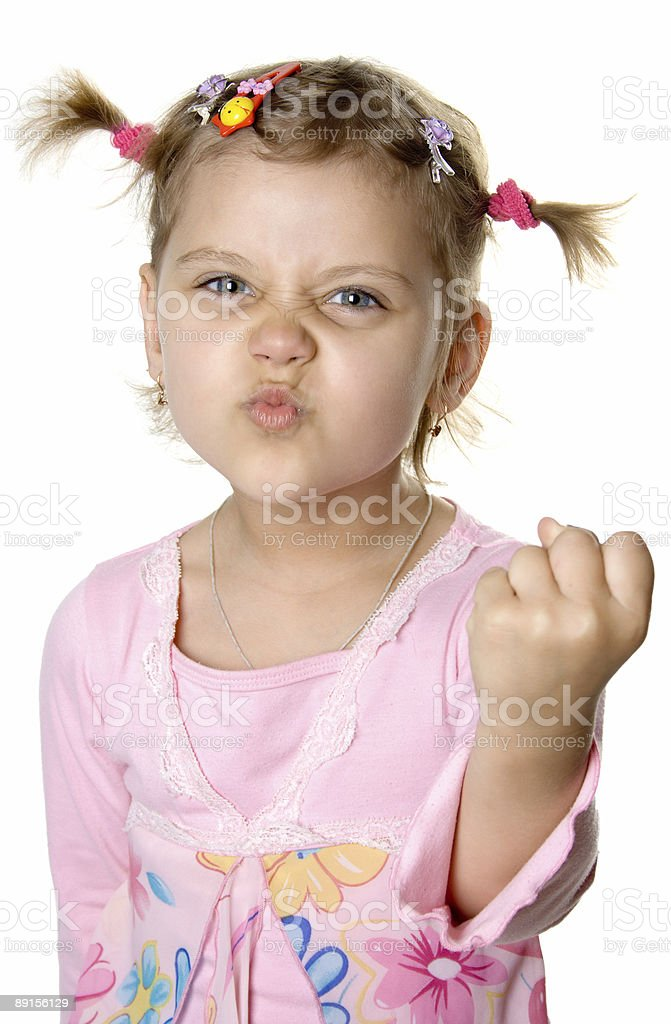 Fun angry girl show fist royalty-free stock photo