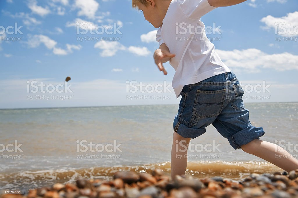 fun at the beach on a glorious day stock photo