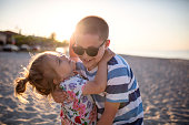 sun protection, cute girl and boy with sun cream at beach vacation