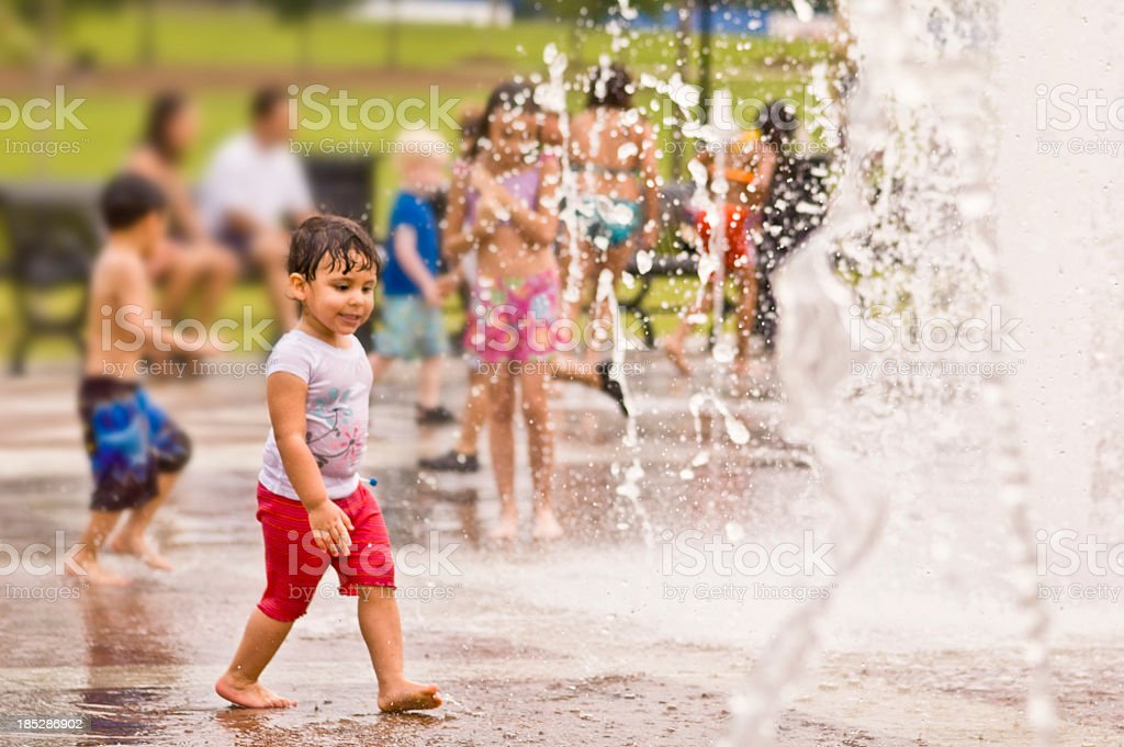 fun at the park fountain stock photo