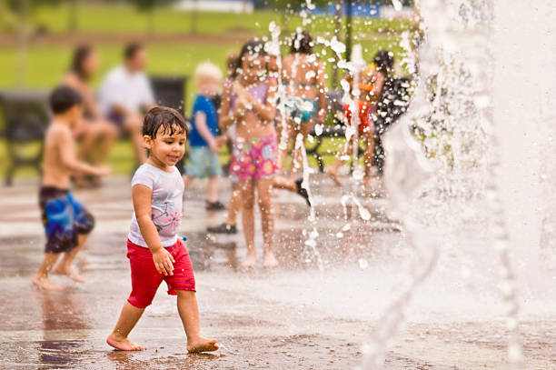 fun at the park fountain stock photo