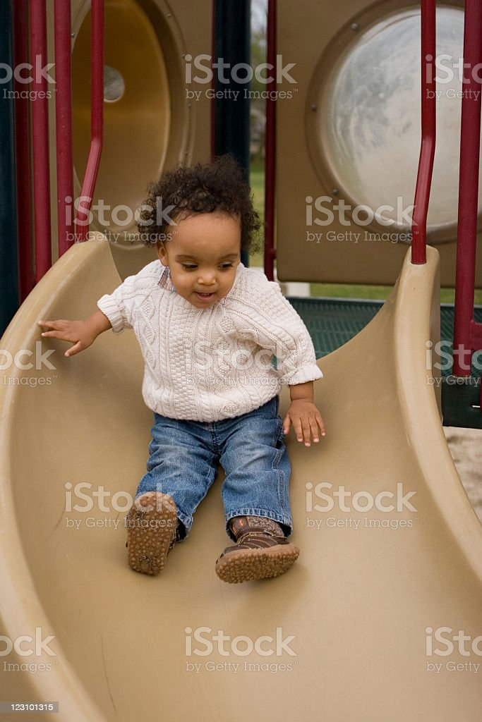 Fun at the park toddler on the slide African-American Ethnicity Stock Photo
