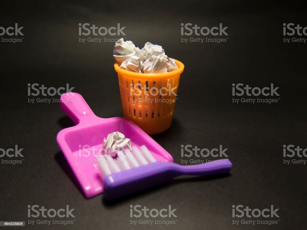 Fun , bright toy bin and brushes on black background stock photo