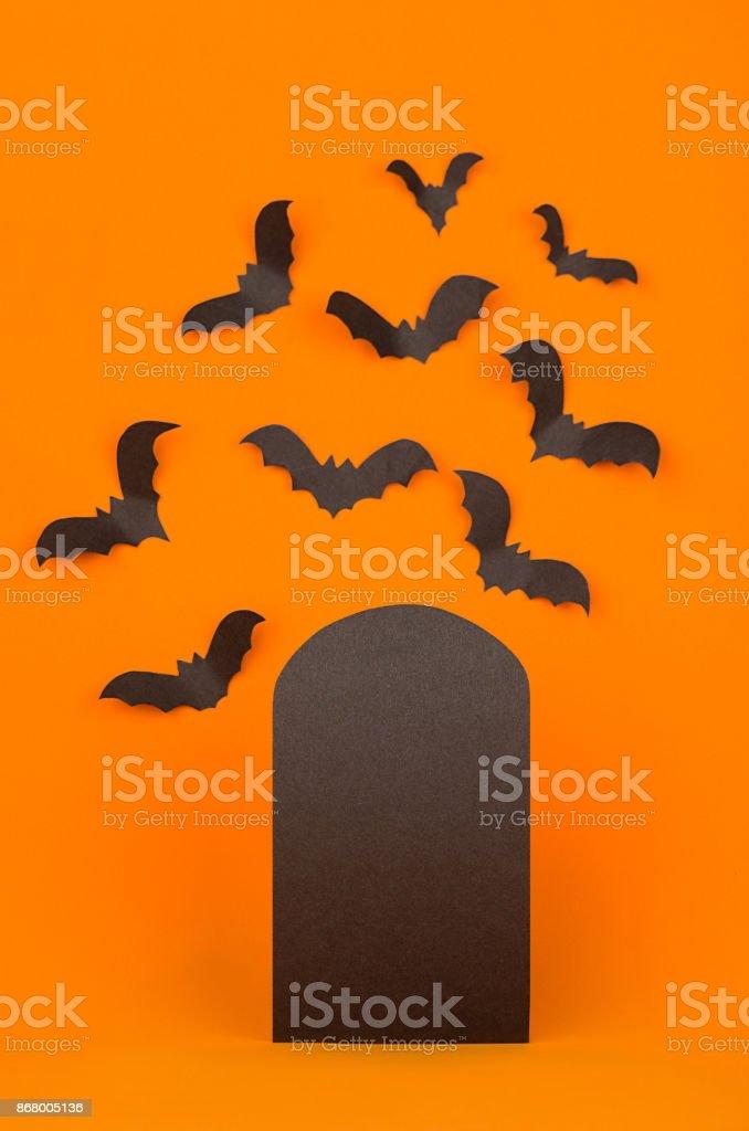 fun cemetery halloween orange background with blank black sale label