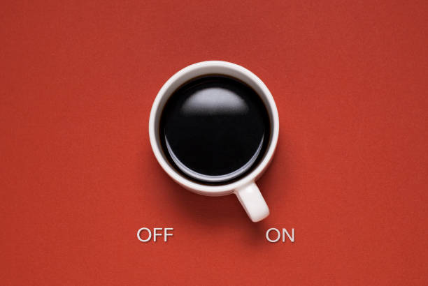 Fun concept of a mug of coffee control switch stock photo