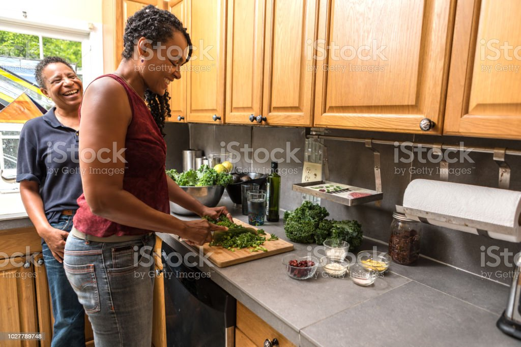 fun conversation while making a meal stock photo