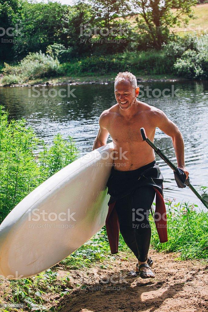 Fun Day Paddleboarding stock photo