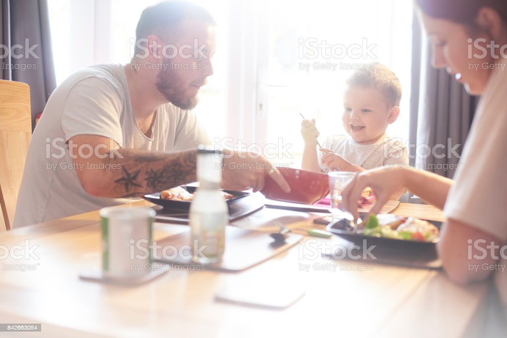 Fun family meal time stock photo
