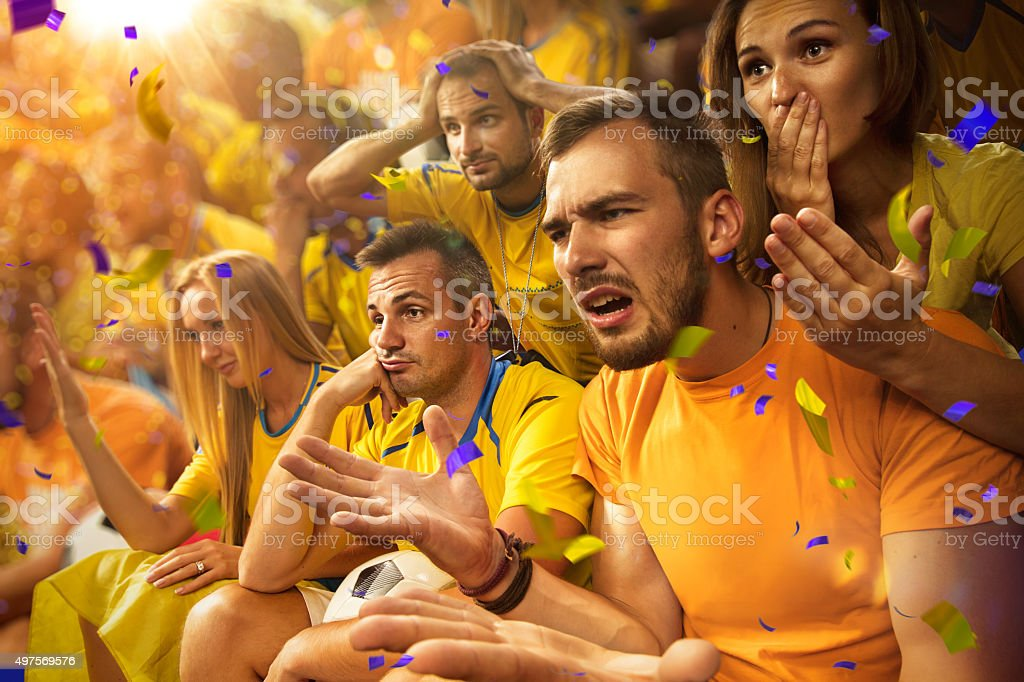 Fun Fans in stadium arena stock photo