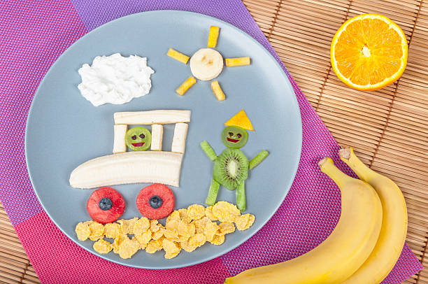 Fun food. Car and people made from fruits stock photo