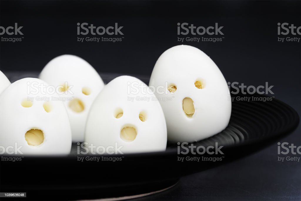 Fun Food for Kids Adorable Halloween Ghost Eggs stock photo