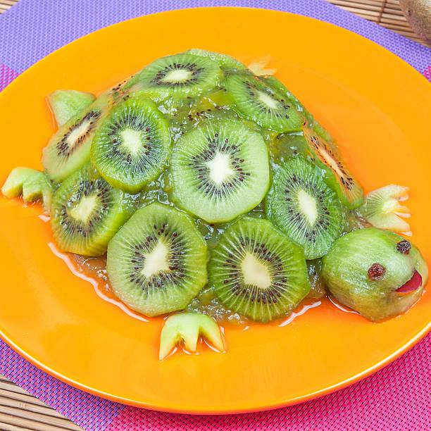 Fun food. Turtle made from kiwi stock photo